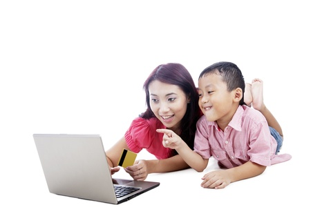 Young asian mother and her son shopping online, isolated on white photo
