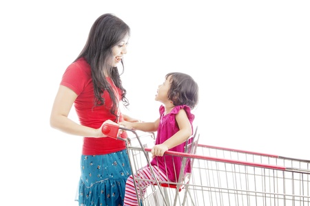 Portrait of asian mother talking and laughing to her daughter on the shopping cart. isolated on white photo
