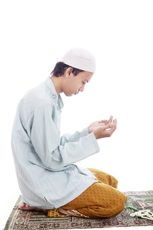forgiveness: Portrait of muslim man worshiping to god. shot in studio isolated on white