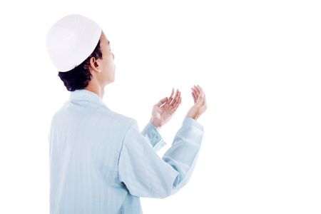 Portrait of muslim man worshiping to god. shot in studio isolated on white photo