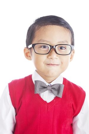elementary student: Portrait of nerdy asian elementary student. shot in studio isolated on white Stock Photo