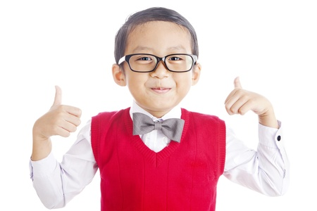 Portrait of asian elementary school student and thumbs-up. shot in studio isolated on white photo