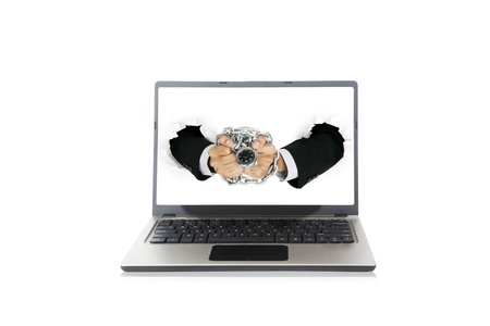Businessman handcuffed by chain and padlock on the monitor, can be used as a symbol of notebook protection by a system Stock Photo - 14683628
