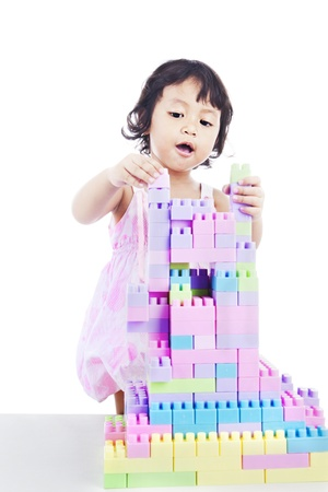 connection block: Portrait of sweet little girl with toy blocks. shot in studio isolated on white