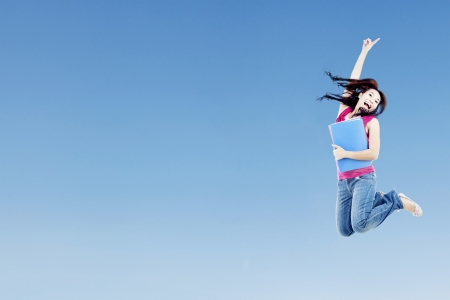 successful student: Portrait of female college student on blue sky with clear sky can be used as copy space