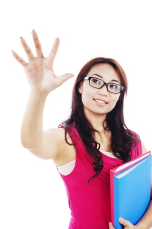 Portrait of female college student with hand gesture touching something on copy space photo