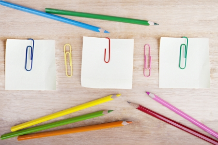 attachments: Group of stationery consists of crayons, post-it, and paperclips Stock Photo