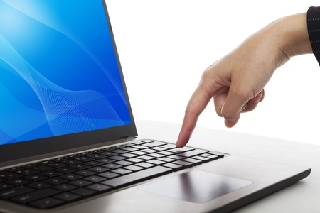 A finger pressing enter button of ultrabook laptop computer Stock Photo - 14821141