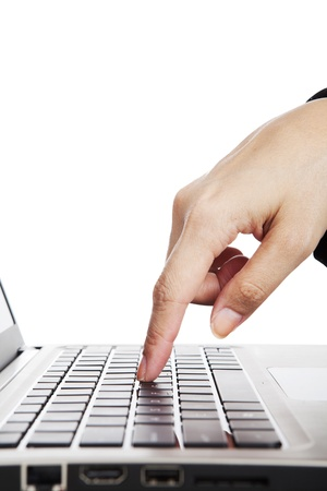 office use: Human finger pressing button on laptop computer