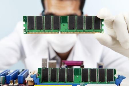 motherboard: A scientist checking the memory card of motherboard