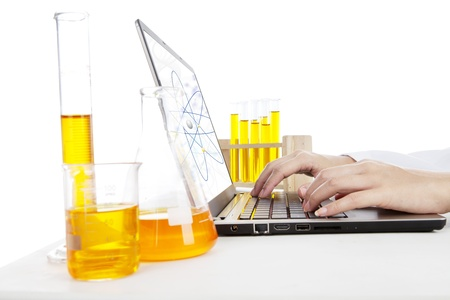 drug test: Hands typing on laptop computer doing an experiment of chemical particle