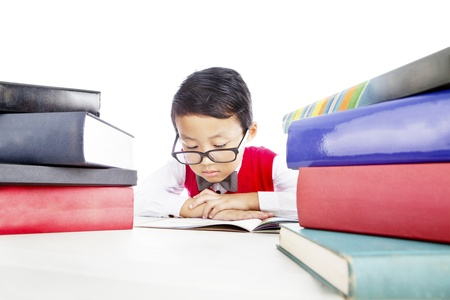 Portrait of asian elementary school student reads books seriously to prepare his test photo