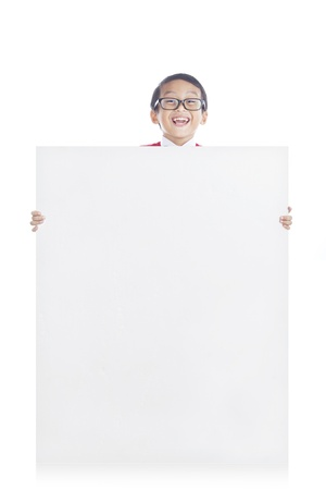 Young asian schoolboy showing blank copyspace. shot in studio isolated on white photo