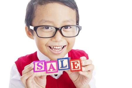 Portrait of asian elementary school student showing SALE word. shot in studio isolated on white Stock Photo - 14779024