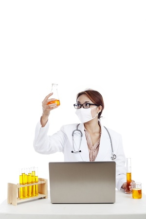 Female scientist looking the reaction result at reaction tube. shot in laboratory photo