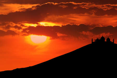 islamic wonderful: Beautiful silhouette of mosque on mountain can be used as islamic wallpaper