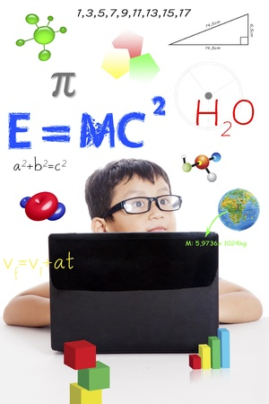 Portrait of smart boy with physics formula and laptop computer photo