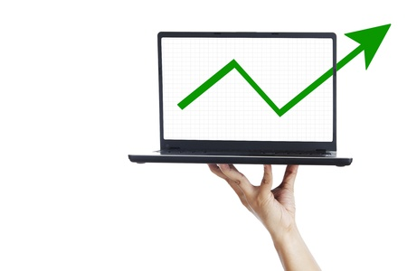 ultrabook: Business graph and ultrabook laptop computer on woman hand