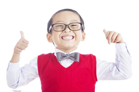 Portrait of successful elementary school student showing his thumbs up on isolated white background Stock Photo - 14779078