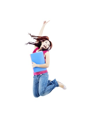 Successful female college student jumping on white background to celebrate her success
