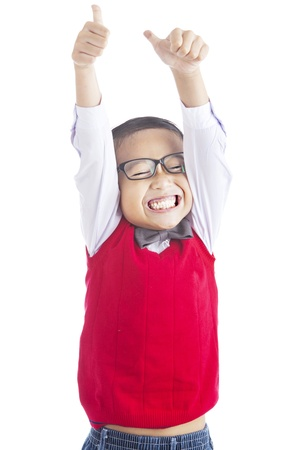 Successful elementary school student showing his thumbs up on isolated white background photo