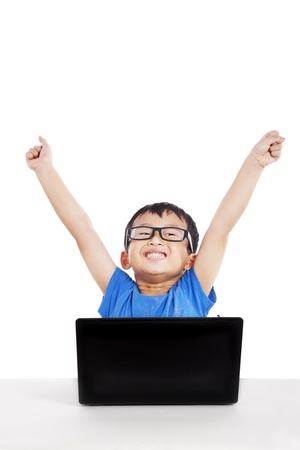black kid: Portrait of successful little student with laptop expressing his success