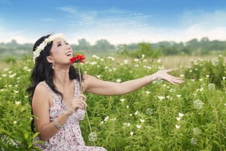 Beautiful asian woman enjoying her summer day playing bubbles outdoor Stock Photo - 14779140