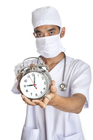 A doctor showing an alarm clock shot in studio isolated on white photo