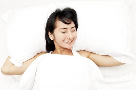 luxuriate: Pretty sleeping woman in white blanket lying in the bed