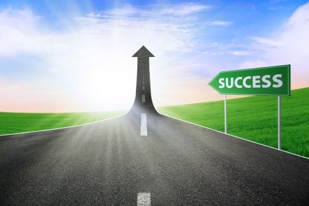 future success: A road turning into an arrow rising upward with a road sign of success, symbolizing the direction to success