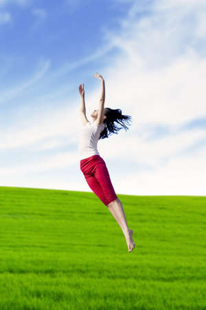 Young woman dancing a ballet dance at meadow. shot outdoor Stock Photo - 14779069