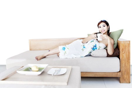 Portrait of beautiful asian woman drinks coffee on sofa photo