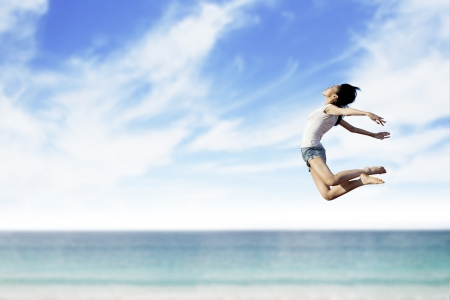 Asian woman flying at the beach. Copy space available for your own text Stock Photo - 14779073