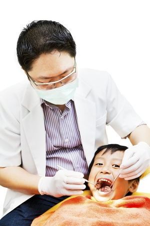 Portrait of asian dentist examining oral cavity at dental clinic photo