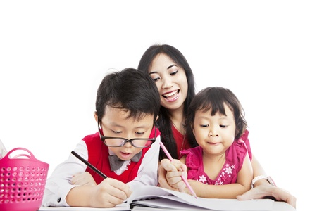 Portrait of young asian mother guiding her children to draw on the paper  photo