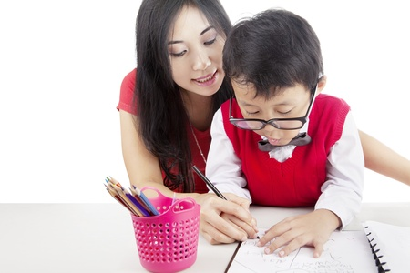 Portrait of elementary school student learn to write with his mother Stock Photo - 15193374