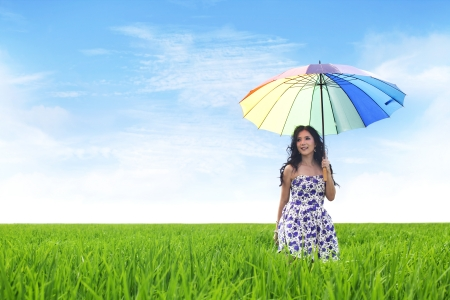 Beautiful Asian woman with umbrella on rice field Stock Photo - 15193375