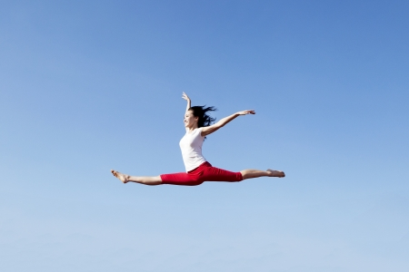 Beautiful Asian Woman jumping gracefuly over blue sky Stock Photo - 15193427