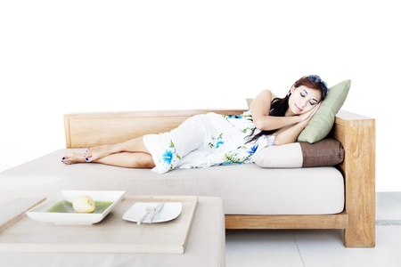 Beautiful asian woman taking a nap on sofa. isolated on white Stock Photo - 15193351