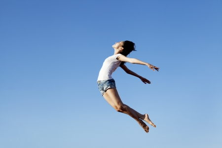 Asian woman flying shot over blue sky. Copy space available for your own text Stock Photo - 15193434