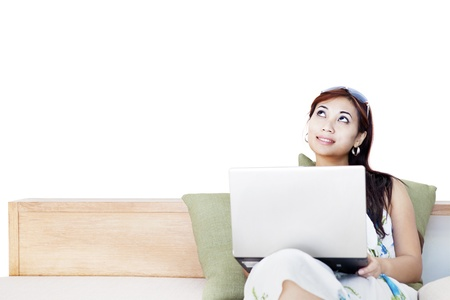 japanese woman: Portrait of beautiful asian woman thinking and using laptop computer on couch Stock Photo