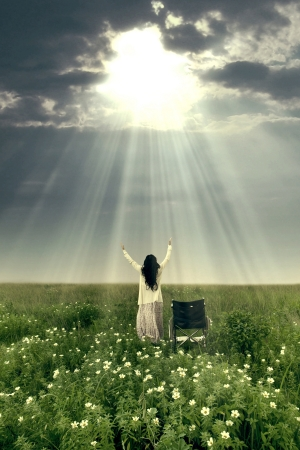 worship white: Woman with wheelchair is being healed by God. Shot in meadow Stock Photo