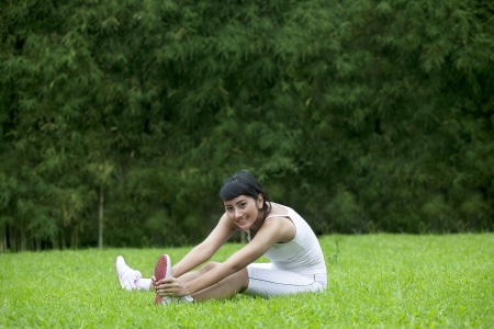 Beautiful asian woman stretching in the park Stock Photo - 15193457