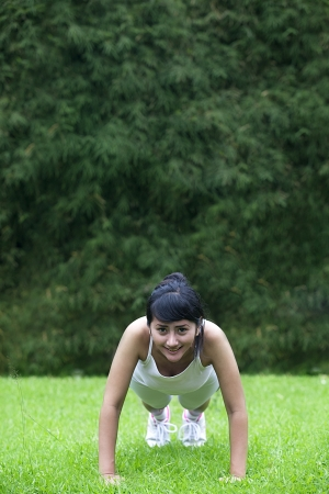 Beautiful asian woman working out outdoor. Shot in summer photo