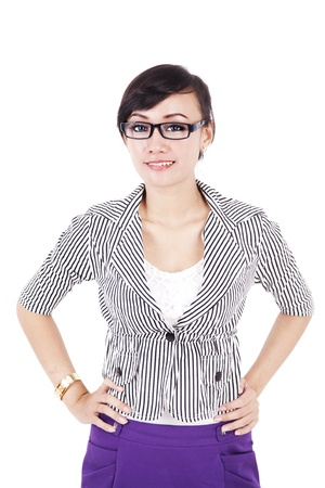 hands on waist: Portrait of a beautiful young business woman standing with hand on waist against white background