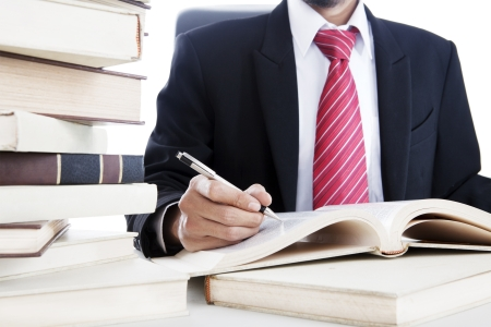 Closeup of businessman writes on a book  shot in the office Stock Photo - 14996462