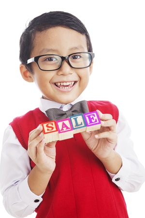 letter blocks: Student holding a letter blocks spelling out sale