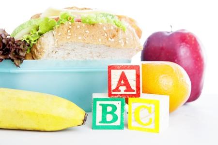 tupperware: Shot of school lunch with alphabet blocks. shot in studio