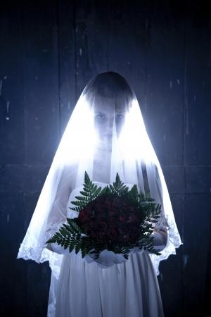 Halloween: Horror scene of a corpse bride standing  photo