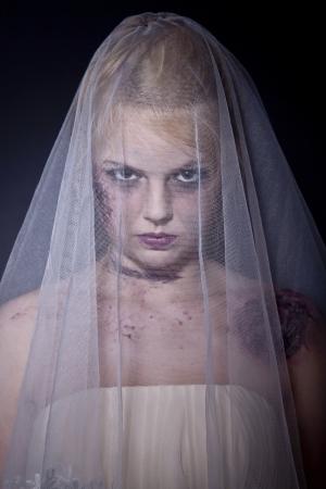 daunting: Halloween: Horror scene of a corpse bride standing. Shot in studio.